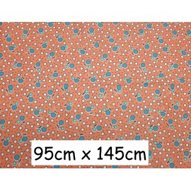 Coupon tissus orange pastel motif cerise 95cm x 145cm